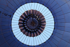 Looking skywards as the top of the hot air balloon canopy is opened after landing. Royalty Free Stock Photos