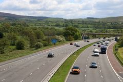 M6 motorway in countryside near Scorton Lancashire. Looking south along the M6 motorway in the countryside near Scorton in Lancashire as the traffic goes round a stock photos