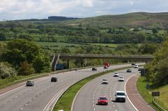 M6 motorway in countryside near Scorton Lancashire. Looking south along the M6 motorway in the countryside near Scorton in Lancashire as the traffic goes round a stock images