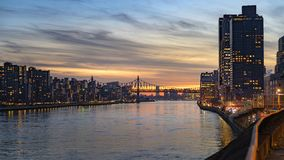 Free Looking Southward Along The East River Toward The 59th Street Bridge On Manhattan`s Upper East Side During Sunset Royalty Free Stock Image - 165791866
