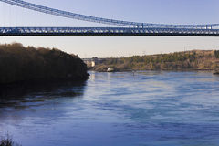 Looking southwards along the Menai Strait with the Menai Suspension Bridge above, Isle of Anglesey, Wales. Grand scenic view southwards along the Menai Strait Stock Images