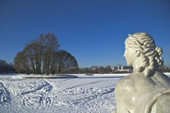 Looking Sphynx. Sculpture of Sphynx in the historical park Tsaritsyno in Moscow looks to the island at the Upper pond. Sunny winter day. Focus on the Sphynx face Royalty Free Stock Photos