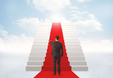 Looking at stairs to heaven. Businessman looking at stairs to heaven Stock Photos