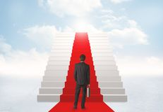 Looking at stairs to heaven. Businessman looking at stairs to heaven Royalty Free Stock Photos