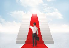 Looking at stairs to heaven. Businessman looking at stairs to heaven Stock Photography