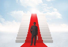 Looking at stairs to heaven. Businessman looking at stairs to heaven Royalty Free Stock Images