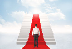 Looking at stairs to heaven. Businessman looking at stairs to heaven Royalty Free Stock Photography