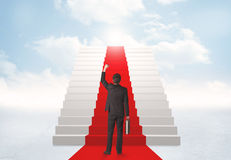 Looking at stairs to heaven. Businessman looking at stairs to heaven Royalty Free Stock Photo