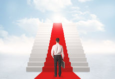 Looking at stairs to heaven. Businessman looking at stairs to heaven Stock Photo