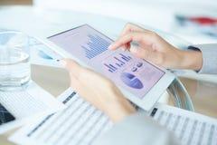Looking through statistics Stock Photos