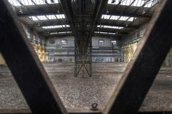 Looking through steel girders in abandoned hall Royalty Free Stock Photography