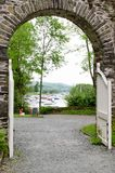 Looking through a stone arch onto Lake Windermere with moored boats Stock Images