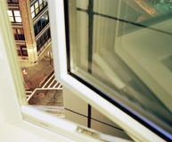 Looking through a street from an half open window in NYC.  Royalty Free Stock Photography