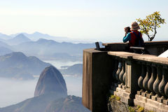 Looking at the Sugar Loaf. Tourist taking picture of the Sugar Loaf in Rio de Janeiro Royalty Free Stock Photos