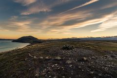 Sunsetting behind Mount John at Lake Tekapo. Looking from the summit of the peninsula walk back at Mount John during sunset. Not sure what the stone circle is Royalty Free Stock Photos