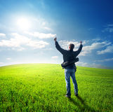 Looking at the sun. Happy young man looking at the sun Royalty Free Stock Photos