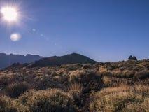 Looking at the sun. Volcanic landscape - mountain range - desert - blue sky - sun stream - no people Royalty Free Stock Photos