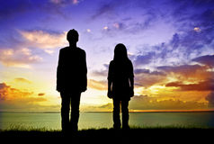 Looking at an sunset. Boy and girl looking at an sunset Stock Photography