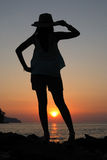 Looking at sunset. She was looking at sunset Royalty Free Stock Photos