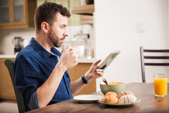Looking at a tablet computer at home Stock Images