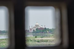 Looking at Taj Mahal from the window of Agra fort royalty free stock photography
