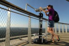 Lady Looking Through Telescope Stock Image