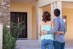 Looking at their brand new house Stock Photo