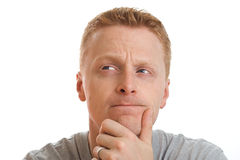 Looking thoughtful. Portrait of a man looking thoughtful, isolated on pure white background stock photo