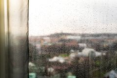 Looking Through A Window With Curtains And Raindrops On The Wind Stock Image