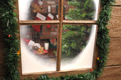 Looking Thru window at Santa Taking Cookie Stock Photos