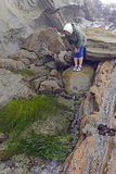 Looking at the Tide Pools at low tide. Near Cape Arago on the Oregon Coast Stock Photos
