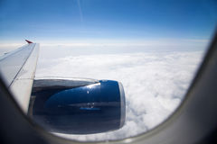 Looking to airplane engine through the window during flight Royalty Free Stock Photography