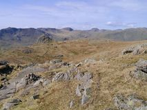 Looking to a distant Great Gable, Lake District. High on Harrison Stickle looking to Great Gable at the back with Pike of Stickle left of centre stock photography