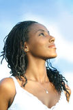 Looking to the future. Woman looking to the sky and smiling Royalty Free Stock Image