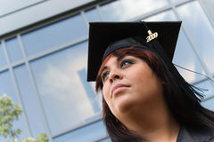 Looking to the Future. A recent graduate thinks about what she will do now that she has completed her education Stock Image