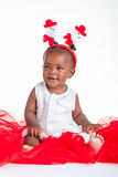 Looking to her side. A 8 month old baby dressed to explore Christmas Stock Image