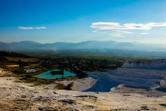 View to the lake from the terrace in Pamukkale. Looking to the lake and houses around from the terrace in Pamukkale Royalty Free Stock Images