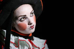 Looking to the moon. Triste girl with clown makeup Royalty Free Stock Photography