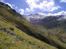 Looking to snow-capped mountain, Lake District Royalty Free Stock Image