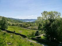 Looking to Windermere across fields and foliage Royalty Free Stock Image