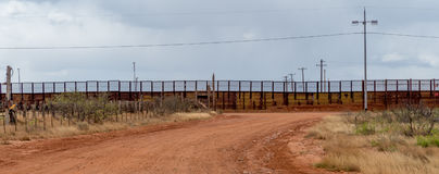 Looking toward the border fence at Naco Arizona. The border fence separating the United States and Mexico at Naco Arizona Royalty Free Stock Photo