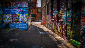 Looking toward Howard Street in the Graffiti Alley, Baltimore, M. Aryland royalty free stock photo