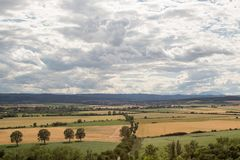 Farmlands on an overcast but sunny day viewed from a lookout tower royalty free stock photos