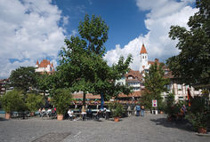 Looking towards the covered bridge Untere Schleusenbrucke at the Muhleplatz in Thun, Switzerland. In the background the City Churc Royalty Free Stock Photos