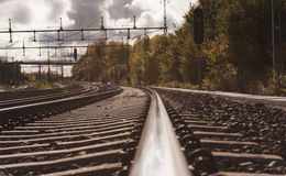 Looking towards a railroad track. And cloudy sky royalty free stock photo