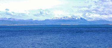 Looking towards to Isla Naverino Chile. The view across the Beagle Channel to Isla Naverino Chile from the coastal walk to the East of Ushuaia Patagonia Stock Photography