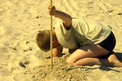 Looking for the treasure. Boy dig big whole Royalty Free Stock Photos