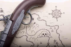 Looking for treasure. A treasure map in the hands of dangerous pirates Stock Image