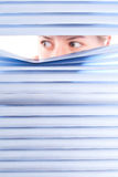 Looking trough blinds. Royalty Free Stock Photo