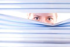 Looking trough blinds Stock Photos